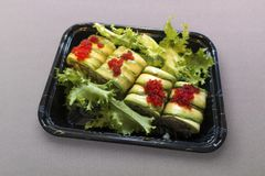 Susi lunch or dinner take out. Alvacado Susi cut rolls dilvery stock images