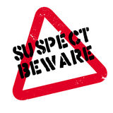 Suspect Beware rubber stamp Royalty Free Stock Photo