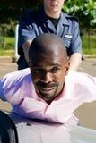 Suspect d'arrestation Photographie stock libre de droits