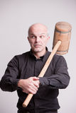 Suspect man with a wooden big hammer Royalty Free Stock Image