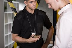 Suspected man talking with policeman. Young suspected men talking with police officer Royalty Free Stock Photography