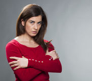 Suspecting 30s woman standing with arms crossed Royalty Free Stock Photo