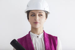 Suspecting woman worker in white safety helmet Royalty Free Stock Image