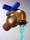 Suspended Animation. Water flowing out of faucet suspended in mid air Royalty Free Stock Photo