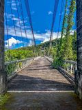 Old suspended bridge in the jungle on la reunion island royalty free stock images