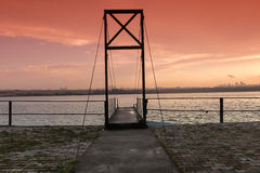 Suspended bridge ship dock and sunset Stock Photography