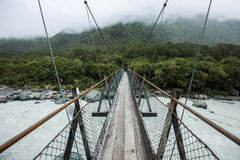 Suspended bridge to the forest. New Zealand Royalty Free Stock Photo