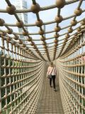 Suspended bridge. View of person walking through suspended bridge Stock Photography