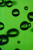 Suspended Bubbles. Green bubbles suspended in thick gel Stock Photos
