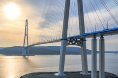 Suspended cable Russian bridge from the mainland of the Far-Eastern city of Vladivostok to the Russky island. Through the Eastern Bosphorus Strait stock photos