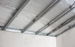 Suspended ceiling of the attic with reflective heat barrier.  Royalty Free Stock Photo