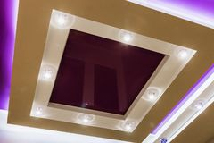 Suspended ceiling and drywall construction in the decoration. Of the apartment or house. focus on the spot Royalty Free Stock Photos
