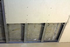 Suspended ceiling from drywall fixed to metal frame with screws.  Stock Photography