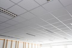 Free Suspended Ceiling With LED Square Lamps Sin The Office Stock Photo - 147237650
