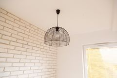 Suspended chandelier in loft style in a modern house interior. Royalty Free Stock Images