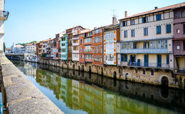 Suspended colored houses over a river in Castres-France. Taken during a long hike Stock Photos