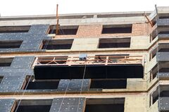 Free Suspended Construction Craddle Near Wall Of Hightower Residentaial Building With Insulation And Ventilated Facade On Stock Images - 169400894