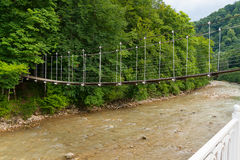 Suspended footbridge over the River Kurdzhips Royalty Free Stock Image