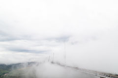 Suspended Highway Bridge in Mist and Clouds Panorama (Millau Viaduct, France) Stock Images