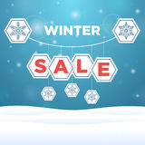 Suspended origami paper with the inscription sale and snowflake Stock Images