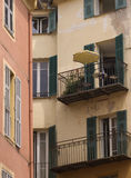 Suspended Patio. Apartment building showing one festive balcony Royalty Free Stock Image