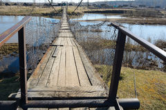The suspended pedestrian bridge Stock Photo