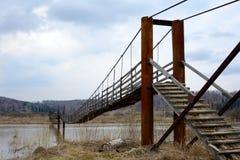 Suspended pedestrian bridge Royalty Free Stock Images