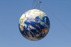 Suspended planet earth balloon Stock Images