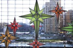 Suspended stars. Decorative christmas stars in a shopping center Stock Image