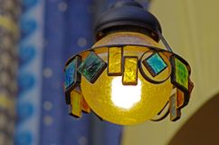 Street lamp made of metal and colored glasses. Suspended street lamp made of metal and colored glasses royalty free stock image