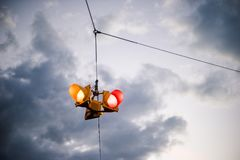 A suspended traffic signal against a moody sky stock photos