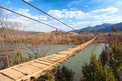 Suspended wooden bridge Stock Photos