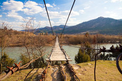 Suspended wooden bridge Royalty Free Stock Image