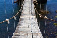 Suspended wooden bridge Stock Photos