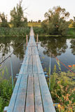 Suspended footbridge over the River Ros, Ukraine. Royalty Free Stock Images