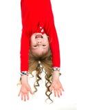 Suspensão da menina de cabeça para baixo Imagem de Stock Royalty Free
