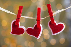 Suspensão de três corações Fotografia de Stock Royalty Free