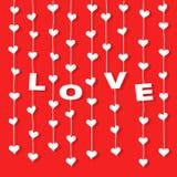 """Suspensão dos corações e letras """"LOVE"""" em cordas Fotos de Stock Royalty Free"""