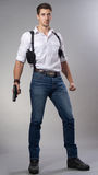 Suspense. Man with a holster holding a gun Stock Image