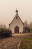 Suspenseful Foggy Autumn Scenery Stock Photo