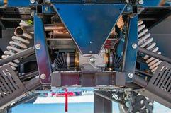Suspensión de un deporte ATV, vista posterior Amortiguadores de choque, primaveras, tracción, protección Servicio del coche Fotos de archivo