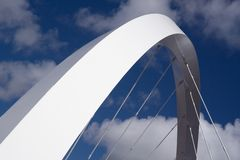 Suspension arc. The supporting arch of the Clyde Arc bridge in Glasgow, Scotland, against blue sky and clouds royalty free stock photography