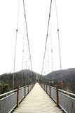 Suspension bridge. In a mountain Royalty Free Stock Photo