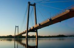 Suspension bridge. Suspension, bridge,  water, sky, blue, light, siberia, krasnoyarsk, Yenisei, river, light, summer Stock Image