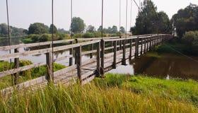 Suspension bridge. Wooden suspension bridge over a river Stock Image
