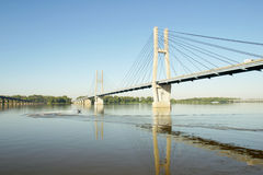 Suspension Bridge. A small motor boat circling under a suspension bridge Stock Images