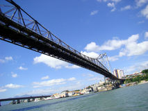 Suspension Bridge. A suspenion bridge calld Hercilio Luz in south of Brazil, with a blue and cloudy sky Stock Images