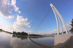 Suspension bridge. Abstract bridge in city Osijek. River Drava reflecting clouds Royalty Free Stock Photography