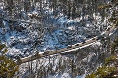 Suspension bridge across alpine highway aerial view royalty free stock images