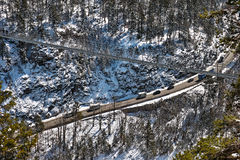 Suspension bridge across alpine highway aerial view Royalty Free Stock Images